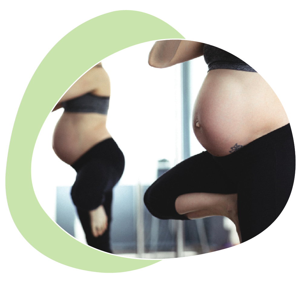 Pregnant Woman Practising Yoga IN Front of a Mirror
